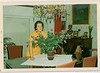 My mother with the same Max Kahrer painting in the back to the right in the early 70s in Belgium