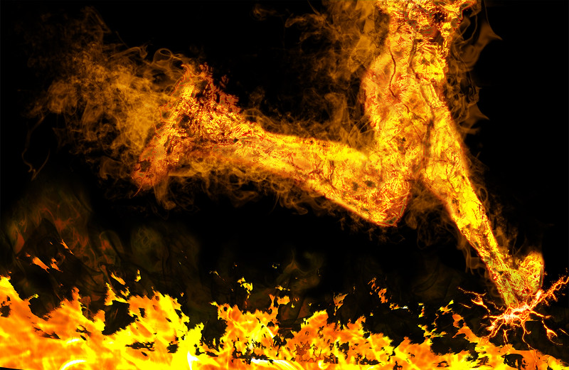 Fiery Running Man On A Black Background