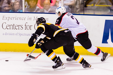 Dylan Reese #2 of the Portland Pirates gets around Chris Breen #8(D) of the Providence Bruins during the Portland Pirates 2014-15 season opener vs the Providence Bruins at the Cross Insurance Arena in Portland, Maine on 10/11/2014. (Photo by Michael McSweeney/Portland Pirates)