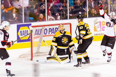 Alex Bolduc #49(C) of the Portland Pirates celebrates and Jeremy Smith #30(G) of the Providence Bruins reacts after a goal is scored by Brendan Shinnimin #24(C) (not pictured) of the Portland Pirates during the Portland Pirates 2014-15 season opener vs the Providence Bruins at the Cross Insurance Arena in Portland, Maine on 10/11/2014. (Photo by Michael McSweeney/Portland Pirates)