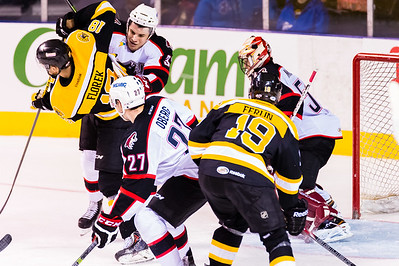 Mark Louis #33(D) of the Portland Pirates tries to clear Justin Florek #18(LW) of the Providence Bruins from in front of the net as Mike McKenna #56(G) of the Portland Pirates readies for a shot during the Portland Pirates 2014-15 season opener vs the Providence Bruins at the Cross Insurance Arena in Portland, Maine on 10/11/2014. Evan Oberg #27(D) of the Portland Pirates and Brian Ferlin #19(F) of the Providence Bruins also pictured. (Photo by Michael McSweeney/Portland Pirates)