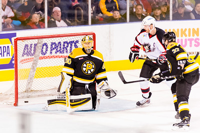 Jeremy Smith #30(G) of the Providence Bruins reacts after a goal is scored by Brendan Shinnimin #24(C) (not pictured) of the Portland Pirates during the Portland Pirates 2014-15 season opener vs the Providence Bruins at the Cross Insurance Arena in Portland, Maine on 10/11/2014. (Photo by Michael McSweeney/Portland Pirates)