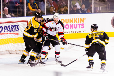 Alex Bolduc #49(C) of the Portland Pirates readies for a deflection while Zach Trotman #37(D) of the Providence Bruins defends during the Portland Pirates 2014-15 season opener vs the Providence Bruins at the Cross Insurance Arena in Portland, Maine on 10/11/2014. (Photo by Michael McSweeney/Portland Pirates)