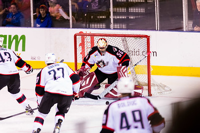Mike McKenna #56(G) of the Portland Pirates makes a save during the Portland Pirates 2014-15 season opener vs the Providence Bruins at the Cross Insurance Arena in Portland, Maine on 10/11/2014. (Photo by Michael McSweeney/Portland Pirates)