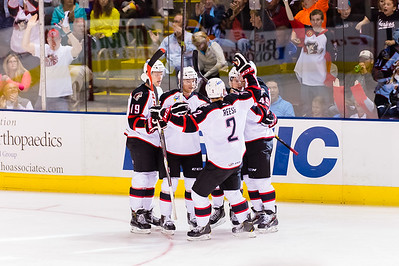 Players celebrate after a goal is scored by Brendan Shinnimin #24(C) of the Portland Pirates during the Portland Pirates 2014-15 season opener vs the Providence Bruins at the Cross Insurance Arena in Portland, Maine on 10/11/2014. (Photo by Michael McSweeney/Portland Pirates)