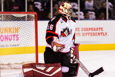 Mike McKenna #56(G) of the Portland Pirates hold the puck after a save during the Portland Pirates 2014-15 season opener vs the Providence Bruins at the Cross Insurance Arena in Portland, Maine on 10/11/2014. (Photo by Michael McSweeney/Portland Pirates)