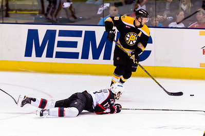 Jordan Martinook #17(C) of the Portland Pirates gets tripped during the Portland Pirates 2014-15 season opener vs the Providence Bruins at the Cross Insurance Arena in Portland, Maine on 10/11/2014. (Photo by Michael McSweeney/Portland Pirates)
