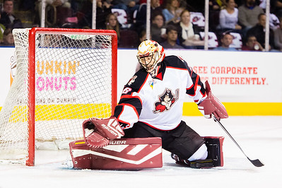 Mike McKenna #56(G) of the Portland Pirates makes an incredible save during the Portland Pirates 2014-15 season opener vs the Providence Bruins at the Cross Insurance Arena in Portland, Maine on 10/11/2014. (Photo by Michael McSweeney/Portland Pirates)
