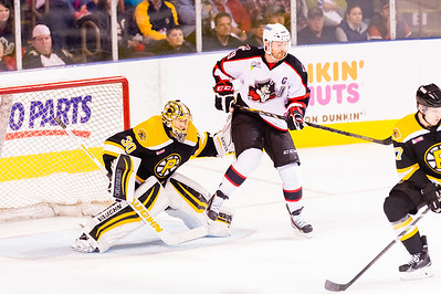 Alex Bolduc #49(C) of the Portland Pirates sets to deflect the puck in front of Jeremy Smith #30(G) of the Providence Bruins during the Portland Pirates 2014-15 season opener vs the Providence Bruins at the Cross Insurance Arena in Portland, Maine on 10/11/2014. (Photo by Michael McSweeney/Portland Pirates)