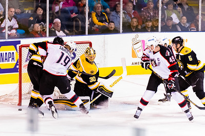 Henrik Samuelsson #19(LW) of the Portland Pirates tries to score while Jeremy Smith #30(G) and Zach Trotman #37(D) of the Providence Bruins defend during the Portland Pirates 2014-15 season opener vs the Providence Bruins at the Cross Insurance Arena in Portland, Maine on 10/11/2014. Also pictured are Alex Bolduc #49(C) of the Portland Pirates and David Warsofsky #5(D) of the Providence Bruins. (Photo by Michael McSweeney/Portland Pirates)
