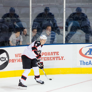 Andrew Campbell #4(D) of the Portland Pirates looks to make a pass as fans cheer him on during the Portland Pirates regular season contest vs. the Syracuse Crunch at the Cross Insurance Arena in Portland, Maine on 10/25/2014. (Photo by Michael McSweeney/Portland Pirates)