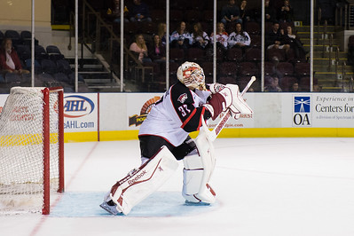 Louis Domingue #37(G) of the Portland Pirates makes a high blocker save during the Portland Pirates regular season contest vs. the Syracuse Crunch at the Cross Insurance Arena in Portland, Maine on 10/25/2014. (Photo by Michael McSweeney/Portland Pirates)