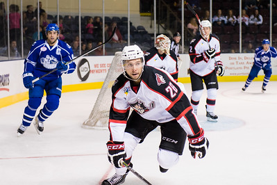 Justin Hache #28(D) of the Portland Pirates looks to defend during the Portland Pirates regular season contest vs. the Syracuse Crunch at the Cross Insurance Arena in Portland, Maine on 10/25/2014. (Photo by Michael McSweeney/Portland Pirates)