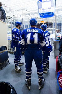 Jerome Samson #11(RW), Jake Dotchin #4(D) and Yanni Gourde #37(LW) of the Syracuse Crunch wait to go on the ice for warm ups. Portland Pirates regular season contest vs. the Syracuse Crunch at the Cross Insurance Arena in Portland, Maine on 10/25/2014. (Photo by Michael McSweeney/Portland Pirates)