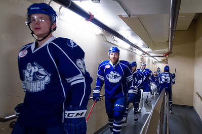 Syracuse Crunch players head up the tunnel to take the ice for warm ups. Portland Pirates regular season contest vs. the Syracuse Crunch at the Cross Insurance Arena in Portland, Maine on 10/25/2014. (Photo by Michael McSweeney/Portland Pirates)