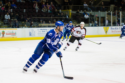 Matthew Corrente #13(D) of the Syracuse Crunch takes the puck up ice during the Portland Pirates regular season contest vs. the Syracuse Crunch at the Cross Insurance Arena in Portland, Maine on 10/25/2014. (Photo by Michael McSweeney/Portland Pirates)