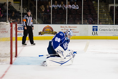Andrei Vasilevskiy #88(G) of the Syracuse Crunch looks in his glove to find the puck not there as it trickles between his pads and almost crosses the goal line during the Portland Pirates regular season contest vs. the Syracuse Crunch at the Cross Insurance Arena in Portland, Maine on 10/25/2014. (Photo by Michael McSweeney/Portland Pirates)