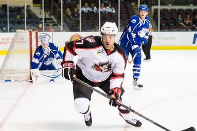 Jordan Martinook #17(C) of the Portland Pirates heads to the corner to get the puck during the Portland Pirates regular season contest vs. the Syracuse Crunch at the Cross Insurance Arena in Portland, Maine on 10/25/2014. (Photo by Michael McSweeney/Portland Pirates)