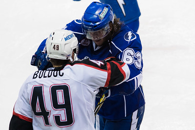 Philippe Paradis #63(LW) of the Syracuse Crunch shoves Alex Bolduc #49(C) of the Portland Pirates after the whistle had stopped play during the Portland Pirates regular season contest vs. the Syracuse Crunch at the Cross Insurance Arena in Portland, Maine on 10/25/2014. (Photo by Michael McSweeney/Portland Pirates)