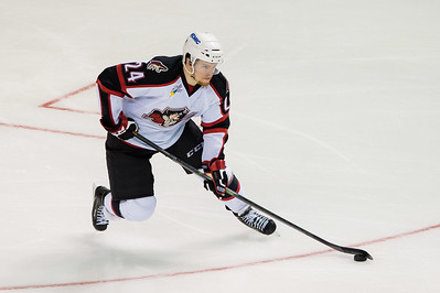Brendan Shinnimin #24(C) of the Portland Pirates brings the puck up ice during the Portland Pirates regular season contest vs. the Syracuse Crunch at the Cross Insurance Arena in Portland, Maine on 10/25/2014. (Photo by Michael McSweeney/Portland Pirates)