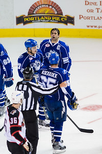 Mike Angelidis #10(C) of the Syracuse Crunch expresses his displeasure to Linesman Alex Stagnone (#7) during the Portland Pirates regular season contest vs. the Syracuse Crunch at the Cross Insurance Arena in Portland, Maine on 10/25/2014. (Photo by Michael McSweeney/Portland Pirates)
