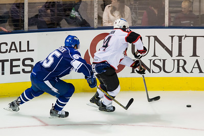 Slater Koekkoek #65(D) of the Syracuse Crunch tries to catch up to Brendan Shinnimin #24(C) of the Portland Pirates during the Portland Pirates regular season contest vs. the Syracuse Crunch at the Cross Insurance Arena in Portland, Maine on 10/25/2014. (Photo by Michael McSweeney/Portland Pirates)