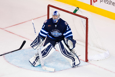 Connor Hellebuyck #37(G) of the St. John's IceCaps readies for a save during the Portland Pirates regular season contest vs. the St. John's IceCaps at the Cross Insurance Arena in Portland, Maine on 10/31/2014. (Photo by Michael McSweeney/Portland Pirates)
