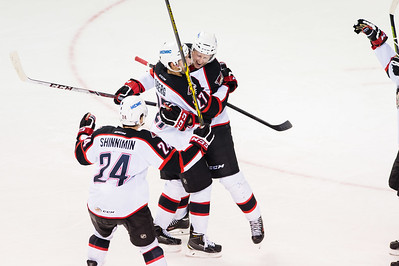 Andrew Campbell #4(D) and Evan Oberg #27(D) of the Portland Pirates celebrate a goal during the Portland Pirates regular season contest vs. the St. John's IceCaps at the Cross Insurance Arena in Portland, Maine on 10/31/2014. (Photo by Michael McSweeney/Portland Pirates)