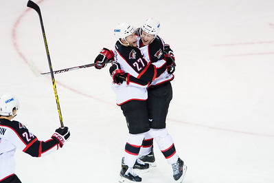 Andrew Campbell #4(D) of the Portland Pirates and Evan Oberg #27(D) of the Portland Pirates celebrate after scoring a goal during the Portland Pirates regular season contest vs. the St. John's IceCaps at the Cross Insurance Arena in Portland, Maine on 10/31/2014. (Photo by Michael McSweeney/Portland Pirates)