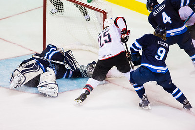 Connor Hellebuyck #37(G) of the St. John's IceCaps makes a save during the Portland Pirates regular season contest vs. the St. John's IceCaps at the Cross Insurance Arena in Portland, Maine on 10/31/2014. (Photo by Michael McSweeney/Portland Pirates)