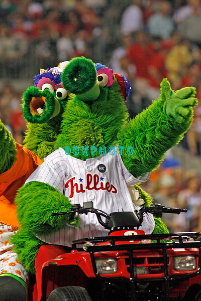 August 20, 2009: Phillie's mascot the Phanatic and Mrs. Phanatic ride double on his ATV after being hoisted by Phillie's fans in between innings during the game between the Arizona Diamondbacks and the Philadelphia Phillies at Citzens Bank Park in Philadelphia, PA. The Phillies defeated the Diamondbacks 12-3. Donald B. Kravitz