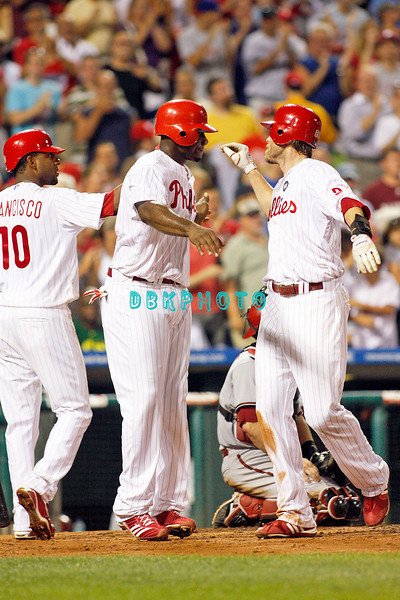 August 20, 2009: Phillie's Rf Jason Werth (28)  gets hgh fives from LF Ben Francisco (10) and 1B Ryan Howard (6) at home after hitting a home run during the game between the Arizona Diamondbacks and the Philadelphia Phillies at Citzens Bank Park in Philadelphia, PA. The Phillies defeated the Diamondbacks 12-3. Donald B. Kravitz