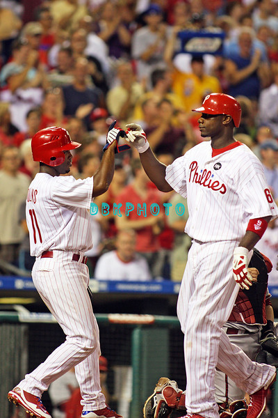 August 20, 2009: Phillie's 1B Ryan Howard (6) gets a high five from Phillies ss Jimmy Rollins (11) after Howard hit a home run to center field during the game between the Arizona Diamondbacks and the Philadelphia Phillies at Citzens Bank Park in Philadelphia, PA. The Phillies defeated the Diamondbacks 12-3. Donald B. Kravitz