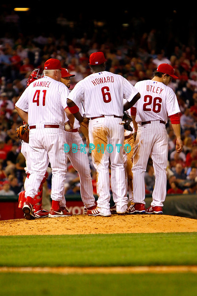 8 September 2008: Philadelphia Phillies' Manager Charlie Manuel (41) is joined on the mound by Ryan Howard (6), Chase Utley (26) and other Phillies as he removes J>C> Romero (16) late in the game against the Florida Marlins. Philadelphia went on to win defeating the Marlins 8-6 in Citizens Bank Stadium in Philadelphia, PA