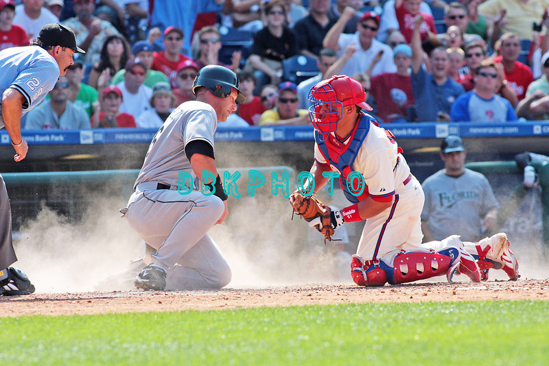 7 August 2008: Philadelphia Phillies' Catcher, Carlos Ruiz, (51) prepares to tag out Luis Gonzalez (26) at home plate as he tried to score late in the game against the Florida Marlins. The Marlins went on to win defeating the Phillies 3-0 in Citizens Bank Stadium in Philadelphia, PA