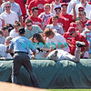 7 August 2008: Florida Marlins' 3rd baseman, Wes Helms (18) falls into the stands among the fans after trying to catch a foul pop-up in the game against the Philadelphia Phillies. The Marlins went on to win defeating the Phillies 3-0 in Citizens Bank Stadium in Philadelphia, PA