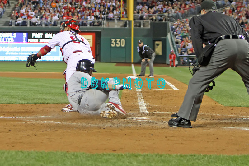 September 19, 2011, Philadelphia, Pennsylvania, U.S. NICK PUNTO, #8 2nd baseman of the Cardinals scores as he slides into home during the game between the Phillie's and the St. Louis Cardinals at Citizens Bank Park, Philadelphia, PA. The Cardinals defeated the Phillie's 4-3.