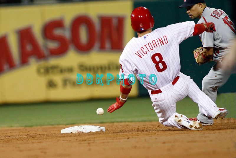 September 19, 2011, Philadelphia, Pennsylvania, U.S. SHANE VICTORINO, #8 outfielder of the Phillie's slides into 2nd base as the ball gets away Cardinals shortstp, RAFAEL FURCAL, #15 during the game between the Phillie's and the St. Louis Cardinals at Citizens Bank Park, Philadelphia, PA. The Cardinals defeated the Phillie's 4-3.