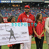 September 19, 2011, Philadelphia, Pennsylvania, U.S. RYAN HOWARD, #6 1st baseman of the Phillie's along with his family and fiancée presents a $50,000 dollar check to The United Negro College Fund from the Ryan Howard Family Foundation prior to the game between the Phillie's and the St. Louis Cardinals at Citizens Bank Park, Philadelphia, PA. The Cardinals defeated the Phillie's 4-3.
