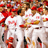 CARLOS RUIZ IS SURROUNDED BY TEAM AFTER HITTING GAME WINNING HOME RUN