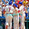 July 12, 2009: Phillies 3rd baseman Pedro Felize (7) is congratulated by Chase Utley (26), Shane Victorino (8) and Ryan Howard (hidden) as he returns to the dugout after his Grand Slam home run in the 1st inning in the game between the Pittsburgh Pirates and the Philadelphia Phillies at Citzens Bank Park in Philadelphia, PA. The Phillies beat the Pirates 5-2. Donald B. Kravitz