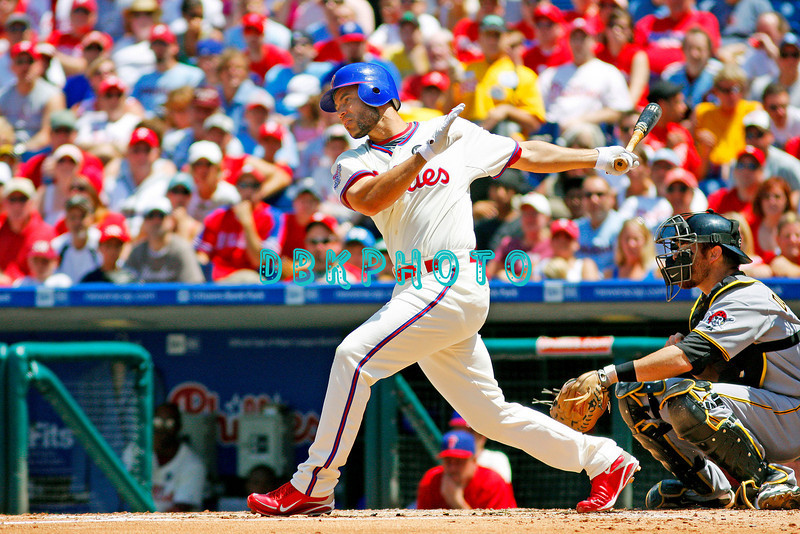 July 12, 2009: Phillies 3rd baseman Pedro Feliz (7) watched the ball land in the seats as he hit a 1st inning grand slam home run during the game between the Pittsburgh Pirates and the Philadelphia Phillies at Citzens Bank Park in Philadelphia, PA. The Phillies beat the Pirates 5-2. Donald B. Kravitz
