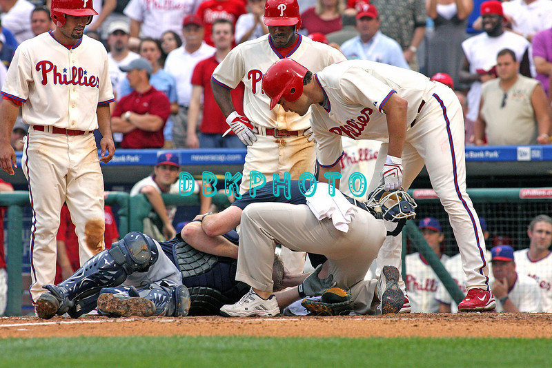 27 July 2008: Philadelphia Phillies' outfielders (L)  Shane Victorino (8), Jimmy Rollins (11) and Pat Burrell (5) (R) whtch Braves Trainer assist Braves catcher Brian McCann who lays motionless after Victorino crashed in to him at a play at home. Philadelphia went on to win defeating the Brave 12-10 in Citizens Bank Stadium in Philadelphia, PA