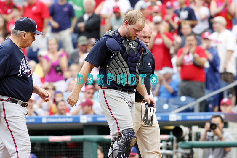 27 July 2008: Braves catcher Brian McCann (16) leaves the field on his own power to a standing ovation from fans follwed by Braves manager, Bobby Cox and the Braves trainer after being injured on a play at home when Phillies outfielder Shane Victorino crashed in to him at a play at home. Philadelphia went on to win defeating the Brave 12-10 in Citizens Bank Stadium in Philadelphia, PA