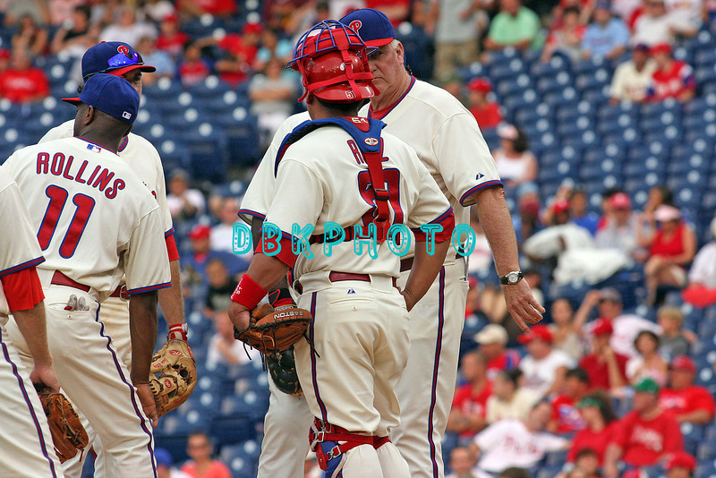 27 July 2008: Philadelphia Phillies' Charlie Manuel (R) walks to the mound to talk to Phillies catcher Carlos Ruiz (51) while (L) Jimmy Rollins (11) and  Chase Utley (26) join the meeting. Philadelphia went on to win defeating the Brave 12-10 in Citizens Bank Stadium in Philadelphia, PA