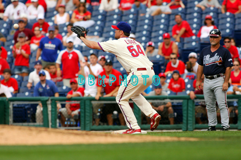 27 July 2008: Philadelphia Phillies' Reliever Brad Lidge (54) goes after the ball tossed to him by Phillies 1st baseman Ryan Howard to end the game. Philadelphia went on to win defeating the Brave 12-10 in Citizens Bank Stadium in Philadelphia, PA