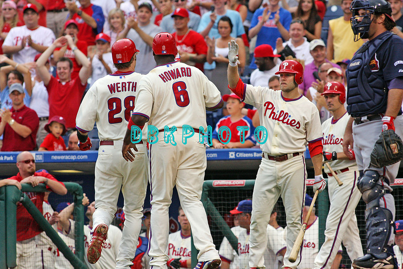 27 July 2008: Philadelphia Phillies' Jason Werth (28) gets a high five from third baseman, Eric Bruntlett (4) (R) while catcher Chris Coste watches as Werth hit home run #14 with Ryan Howard (6) aboard. Philadelphia went on to win defeating the Brave 12-10 in Citizens Bank Stadium in Philadelphia, PA