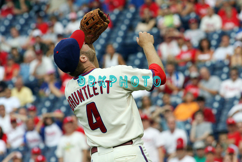 27 July 2008: Philadelphia Phillies' third baseman Eric Bruntlett (4) has a bead on a pop up late in the game against the Atlanta Braves. Philadelphia went on to win defeating the Brave 12-10 in Citizens Bank Stadium in Philadelphia, PA