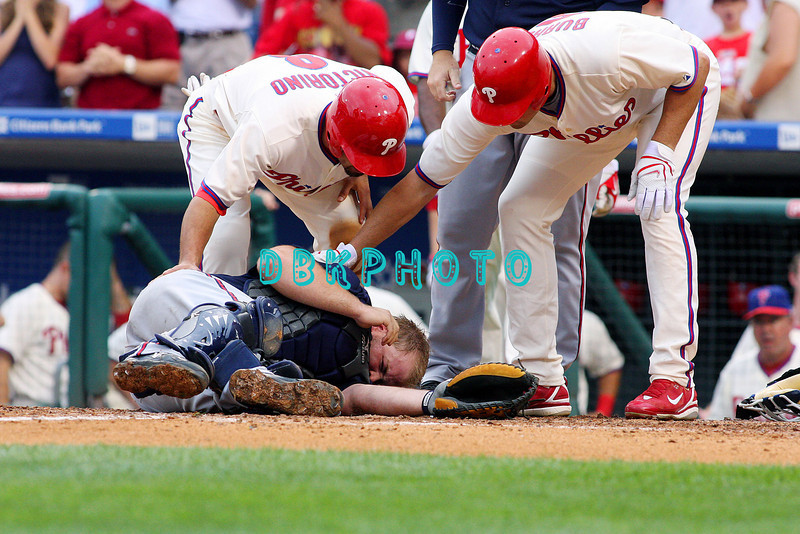 27 July 2008: Philadelphia Phillies' outfielders Shane Victorino (8) and Pat Burrell (5) try to assist Braves catcher Brian McCann who lays motionless after Victorino crashed in to him at a play at home. Philadelphia went on to win defeating the Brave 12-10 in Citizens Bank Stadium in Philadelphia, PA