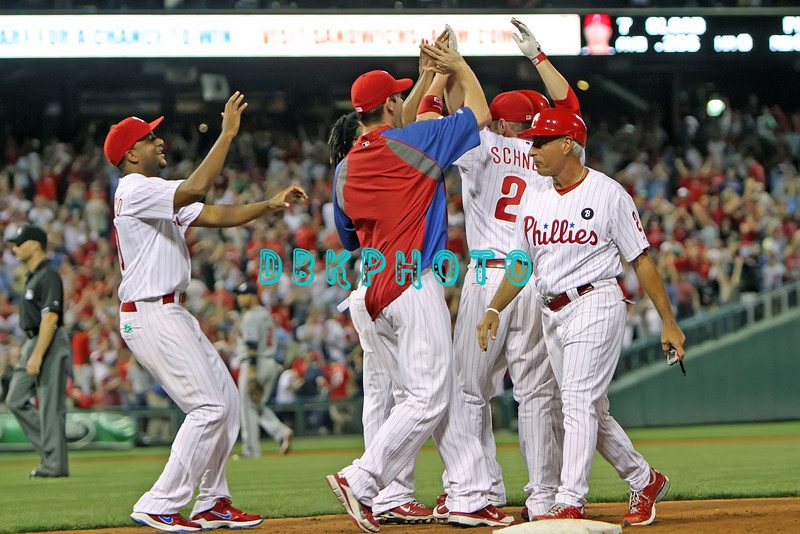 September 7, 2011 Philadelphia Phillie's congratulate each other after Ross Gload hit a pinch hit single to right to end the game against the Atlanta Braves at Citizens Bank Park in Philadelphia, PA. The Phillie's defeated the Braves 3-2.